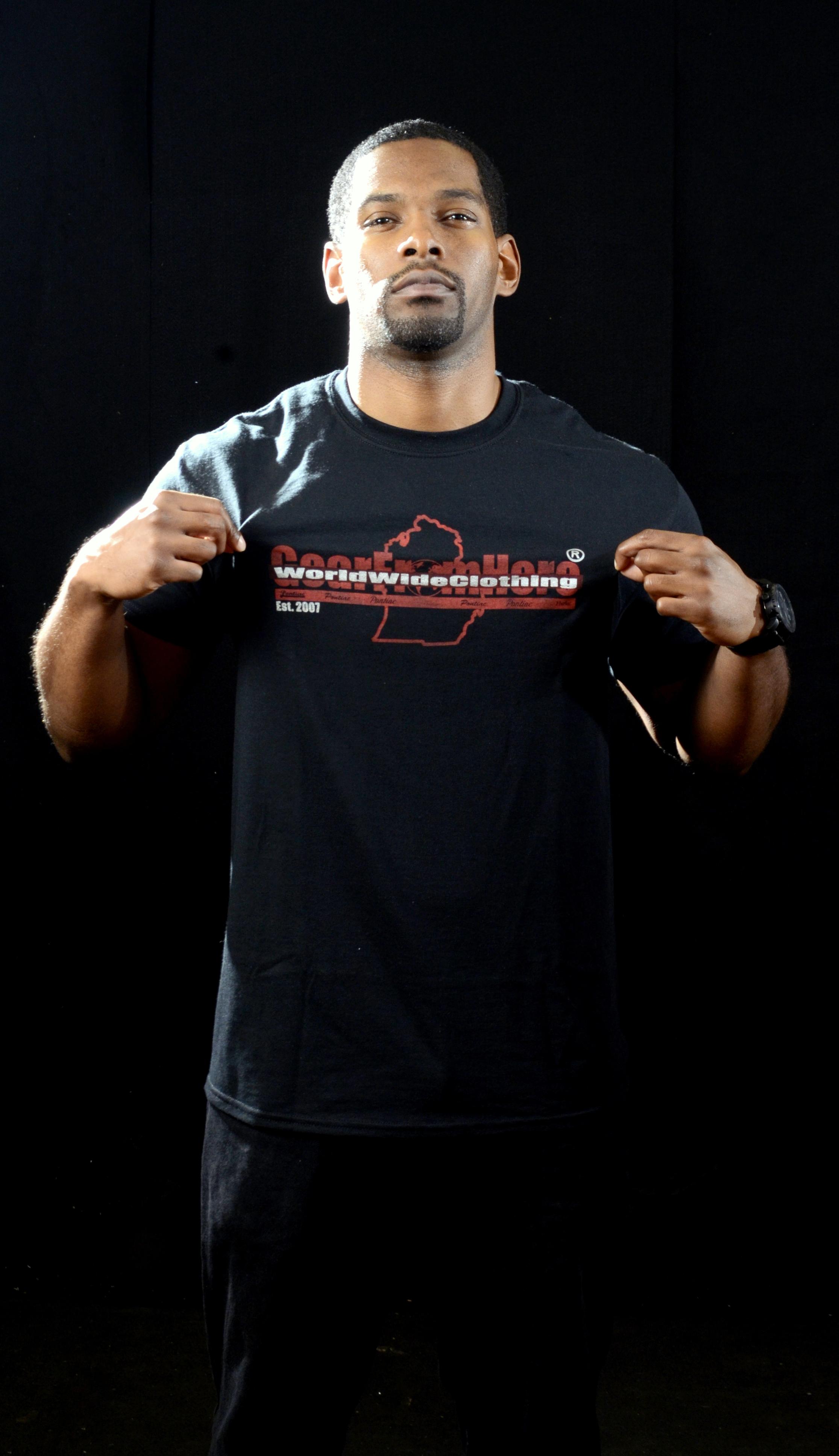 Man wearing black WorldwideClothing Michigan t-shirt